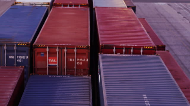 low drone flight across cargo containers - mezzo di trasporto video stock e b–roll