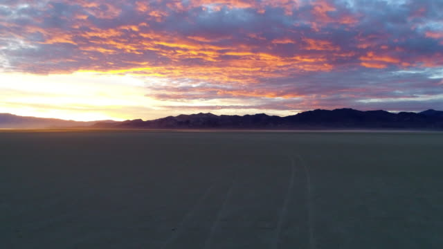 low elevation aerial over blackrock desert at sunset - nevada stock-videos und b-roll-filmmaterial