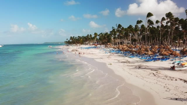 low elevation: sunny day on a beach in punta cana - punta cana stock videos and b-roll footage
