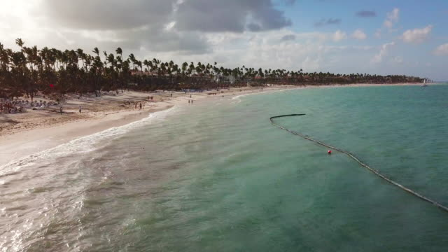 low elevation:êbeach on a cloudy day in punta cana - punta cana stock videos and b-roll footage