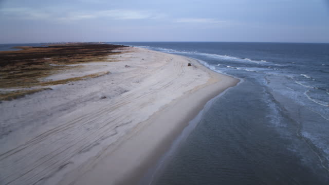 Low fast flight above beach and surf, heading for Beach Haven, New Jersey. Shot in November 2011.