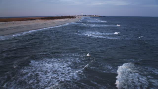 low fast flight over beach and surf, heading for beach haven, new jersey. shot in november 2011. - artbeats bildbanksvideor och videomaterial från bakom kulisserna