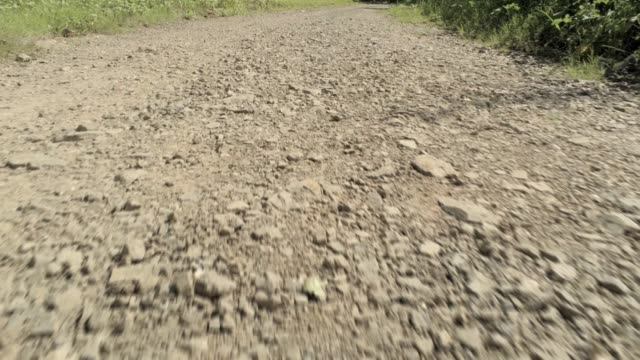 low flight forwards over a dirt road - aerial footage