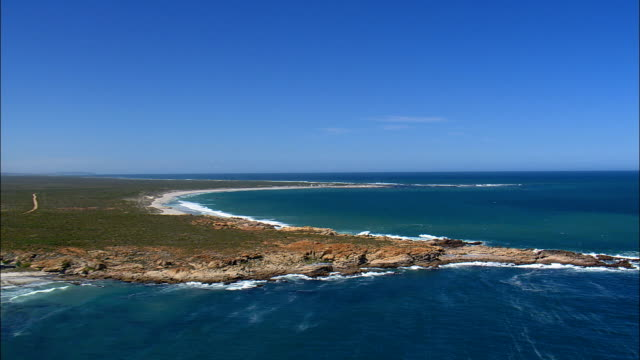 low flight over rocky peninsula - aerial view - western cape,  south africa - peninsula stock videos & royalty-free footage