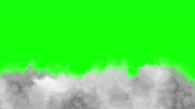 vídeos y material grabado en eventos de stock de low floating clouds on a green background. - fog