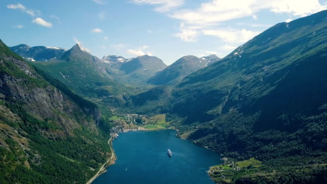 low flying aerial of geiranger fjord in the summer - norway stock videos & royalty-free footage