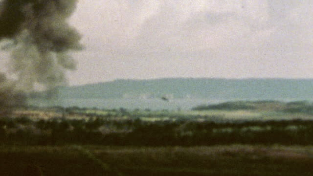 vídeos y material grabado en eventos de stock de ts low flying aircraft dropping a fire bomb on a wooded area explosion fireball and rising smoke during wwii / tinian mariana islands¬† - tinian