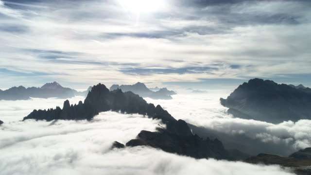 low level clouds surrounding mountain peaks in the dolomites, italy - tre cimo di lavaredo stock videos & royalty-free footage