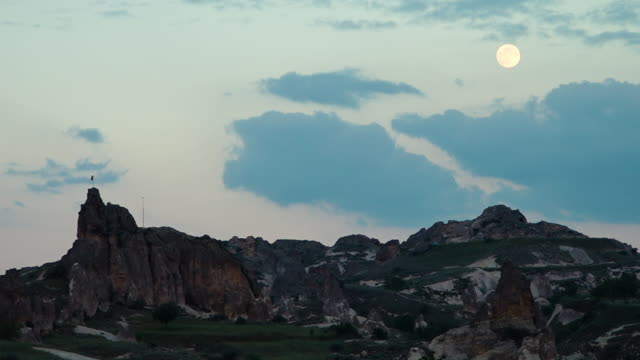low light rocky uneven terrain with the moon and a turkish flag - uneven stock videos & royalty-free footage