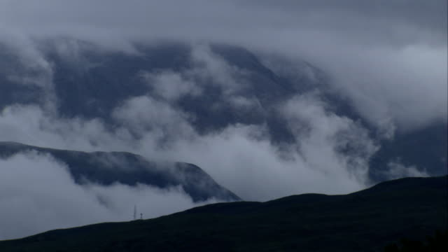 low lying clouds settle between scottish hills. available in hd. - scottish highlands stock videos & royalty-free footage