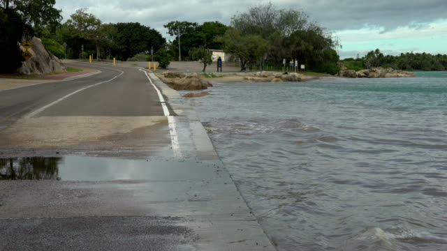 low lying road in australia prior to cyclone debbie vulnerable to storm surge flooding - 沿岸点の映像素材/bロール