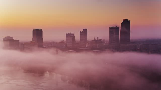 low mist on arkansas river with little rock skyline at sunrise - aerial - arkansas stock videos & royalty-free footage