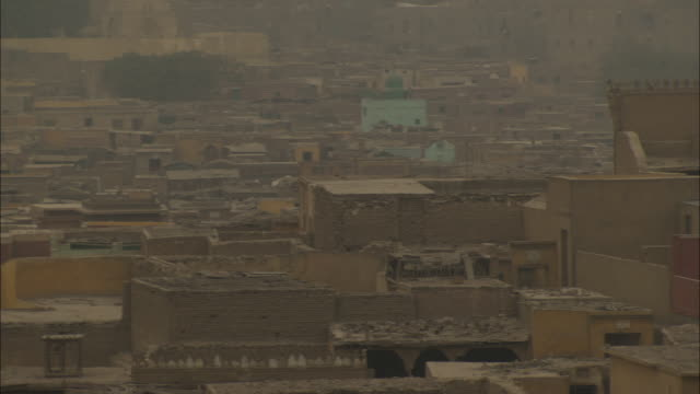 low, mud brick houses crowd a neighborhood in cairo. - air pollution stock videos & royalty-free footage