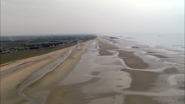 low over beach - aerial view - lower normandy, france - d day stock videos & royalty-free footage