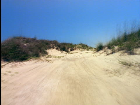 stockvideo's en b-roll-footage met low point of view over sand dunes on beach / padre island, texas - padre
