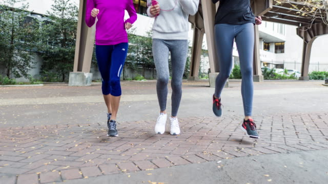 low section front view video of three women running in new york - low section stock videos and b-roll footage