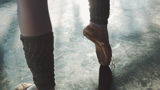 low section of ballerina balancing on tiptoe - tiptoe stock videos & royalty-free footage
