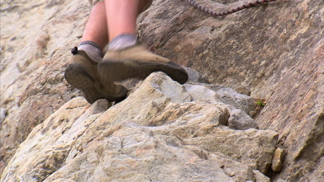 cu low section of man climbing down face of mountain / provo, utah, usa - provo stock videos & royalty-free footage
