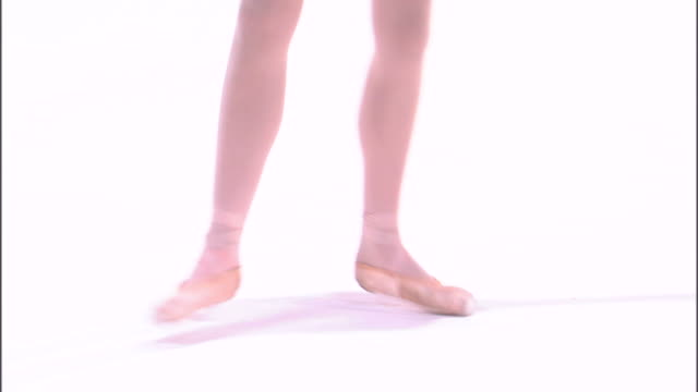 ms low section of teenage (16-17) ballerina jumping, against white background / orem, utah, usa - en pointe stock videos and b-roll footage