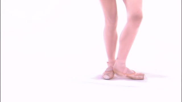 ms low section of teenage (16-17) ballerina jumping, against white background / orem, utah, usa - stockings stock videos & royalty-free footage