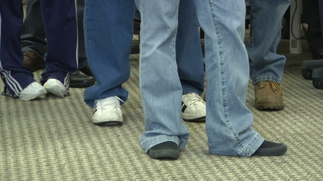 cu, pan, low section of unemployed workers line up at michigan works office, livonia, michigan, usa - waiting in line stock videos & royalty-free footage