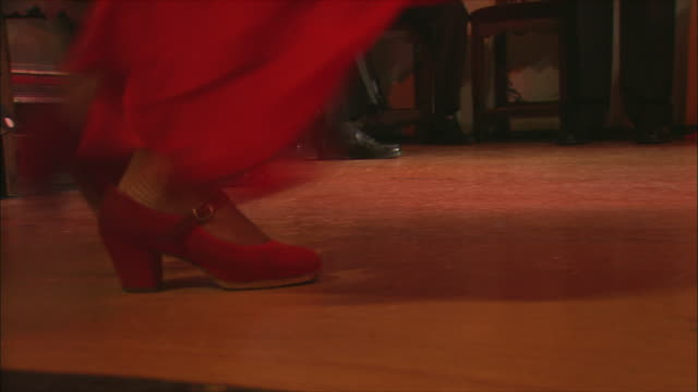 cu low section of woman in red dress flamenco dancing, madrid, spain - flamenco dancing stock videos and b-roll footage