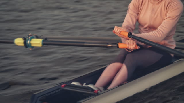 low section of woman rowing boat in river - sculling stock videos & royalty-free footage