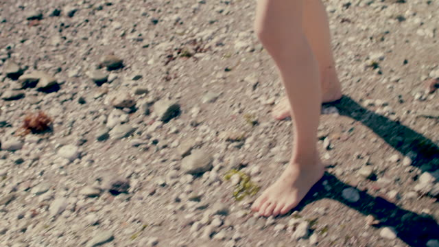 low section of woman walking on beach barefoot - kingsand video stock e b–roll