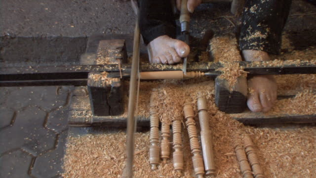 cu zi low section of wood carver working with hand and foot, marrakech, morocco - tradition stock videos & royalty-free footage