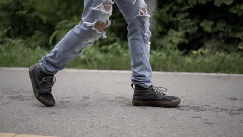low section view of asian man in fashion  straight slim pants damage hole denim jean pants ripped skinny trousers walking - trousers stock videos & royalty-free footage