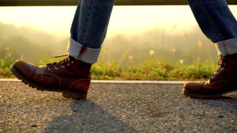 low section view of leather boot walking in the morning - hiking stock videos & royalty-free footage