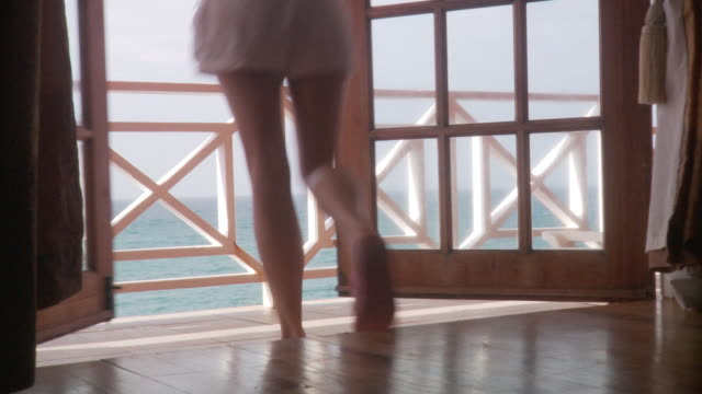 cu low section young woman opening double doors and standing on sea-front balcony before returning indoors/ scarborough, tobago, trinidad and tobago - flip flop stock videos and b-roll footage