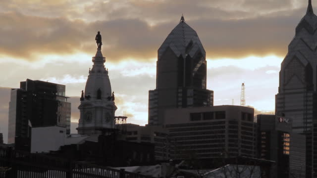 la a low sitting sun illuminating the city skyline / philadelphia, pennsylvania, united states - william penn stock videos and b-roll footage