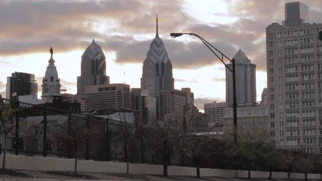 ws a low sitting sun illuminating the city skyline / philadelphia, pennsylvania, united states - william penn stock videos and b-roll footage