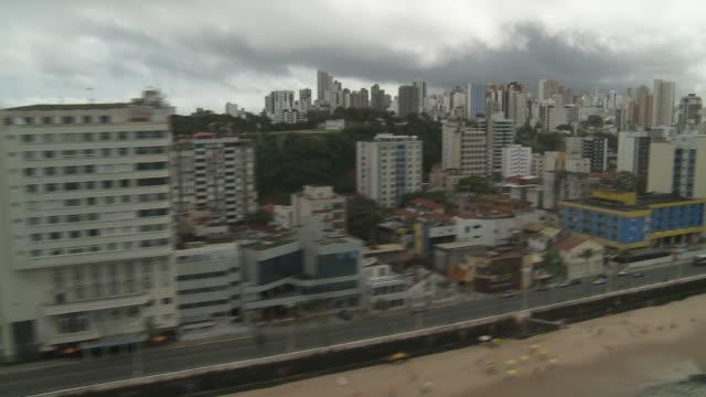 vídeos y material grabado en eventos de stock de low storm clouds gather over a lighthouse in salvador, brazil. - bahía