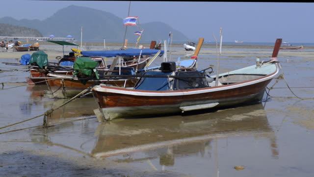 low tide on rawai beach, phuket island, thailand - bassa marea video stock e b–roll