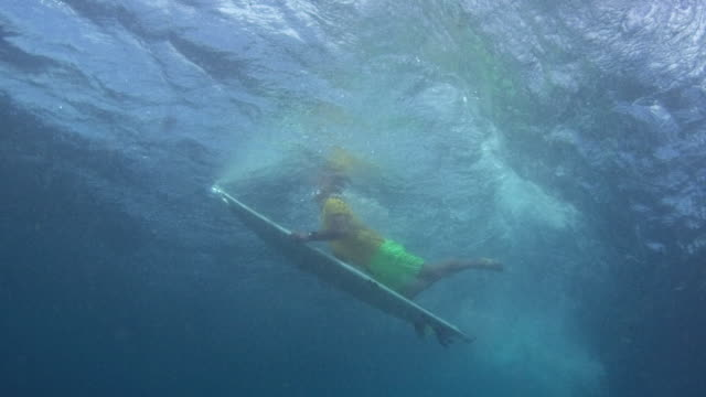 low underwater shot of surfer dipping beneath wave - only mature men stock videos & royalty-free footage
