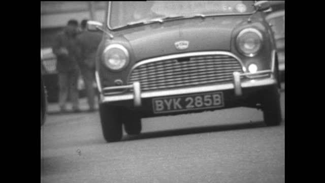 low view cars driving along london road; 1967 - surface level stock videos & royalty-free footage