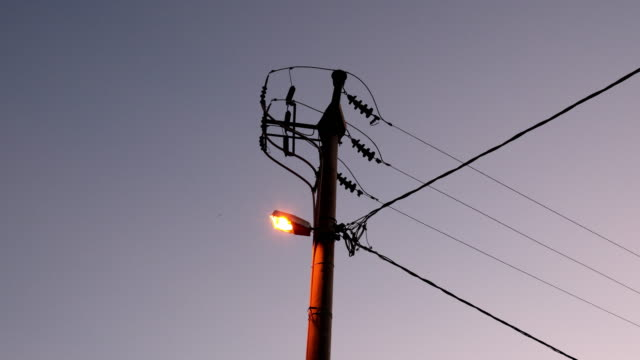 low voltage electric pole with street lamp - transformer stock videos & royalty-free footage