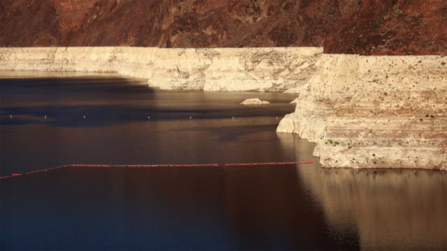 low water level of lake mead reservoir at hoover dam - hoover dam stock videos and b-roll footage