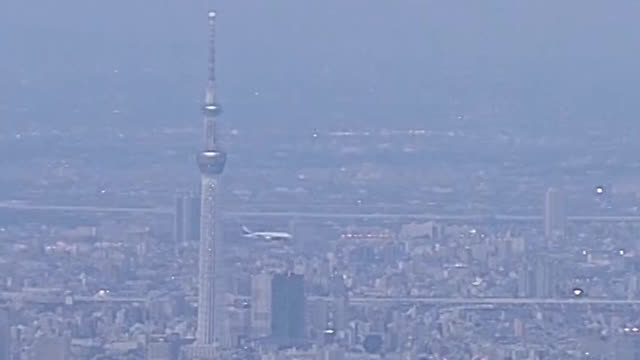 low-altitude test flights over central tokyo started on feb. 2 for passenger planes landing at haneda airport, drawing noise complaints and raising... - complaining stock videos & royalty-free footage