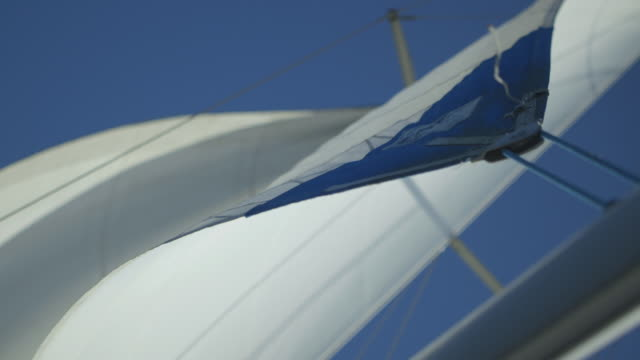 low-angle, close-up shot of the corner detail of a yacht's sail in use, uk. - sail stock videos and b-roll footage