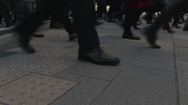 low-angle, commuters legs, tokyo, japan - marunouchi stock videos & royalty-free footage