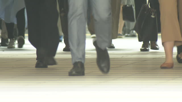 low-angle, crowd of busy commuters, tokyo, japan - minato ward stock videos & royalty-free footage