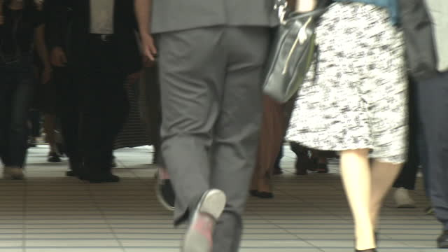 low-angle, crowd of busy commuters, tokyo, japan - braille stock videos & royalty-free footage