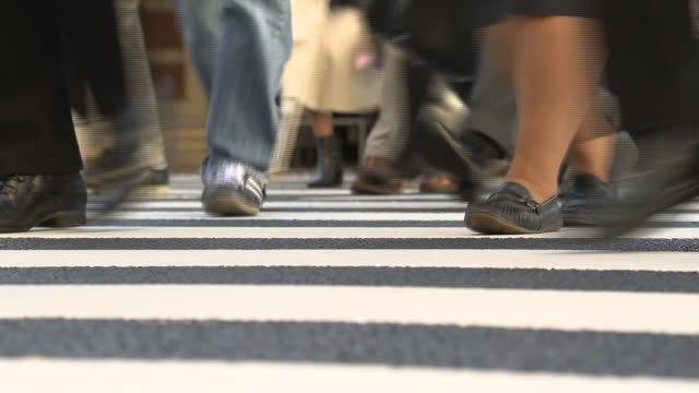 low-angle, feet and legs of pedestrians, tokyo, japan - low angle view stock videos & royalty-free footage