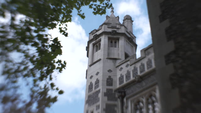 low-angle, fish-eye effect shot of a tower at st bartholomew-the-great church in london, uk. - カジモド点の映像素材/bロール