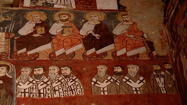 low-angle mcu of medieval frescoes of saints and clergy, in the monastery church. saint moses the abyssinian is a monastic community of the syriac... - circa 11th century stock videos & royalty-free footage