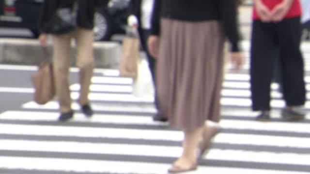 low-angle, pedestrians crossing crosswalk, tokyo, japan - minato ward stock videos & royalty-free footage