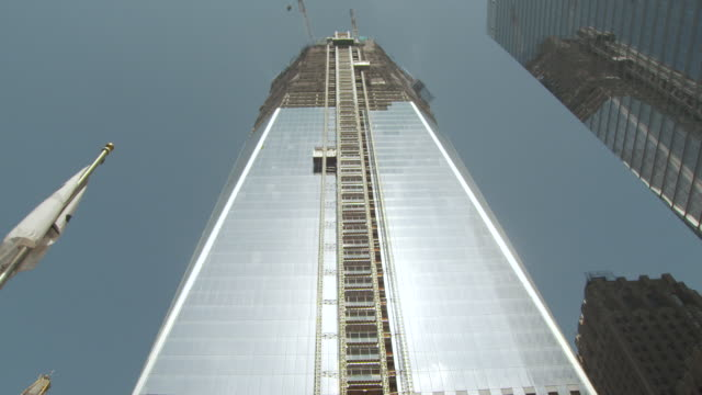 low-angle sequence showing the new one world trade center under construction in summer 2011, manhattan, new york city, usa. - september 11 2001 attacks stock videos & royalty-free footage